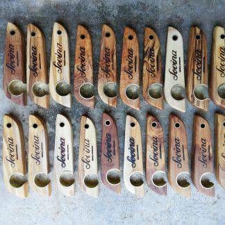 Saca-caricas de madeira